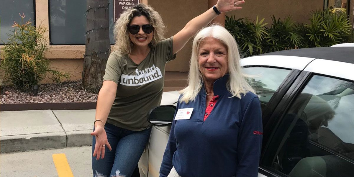 A volunteer from Mainline Insurance helps donate a car to a Big Table Care Recipient!